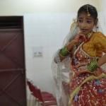 Child artist charecterizing Radha in a dance performance