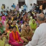 Bk Brother Sahuji addressing audience and explaining spiritual significance of Janmashtmi